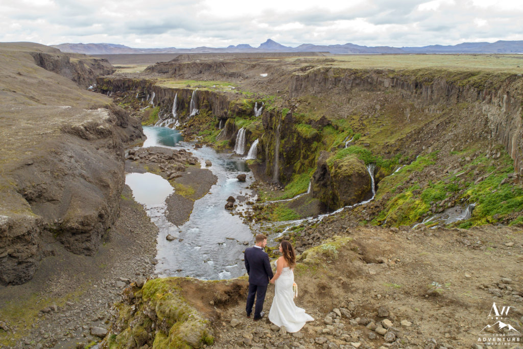 Iceland Wedding Couple looking at each other in front of a canyon