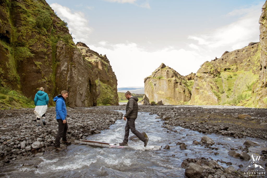 Groom crossing a river in Iceland
