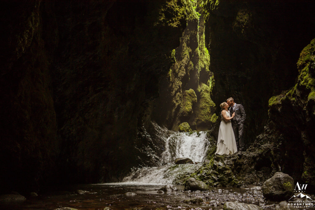 Couple kissing inside a canyon in Iceland