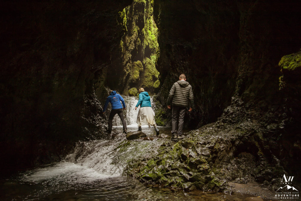 Couple hiking through a river in Iceland