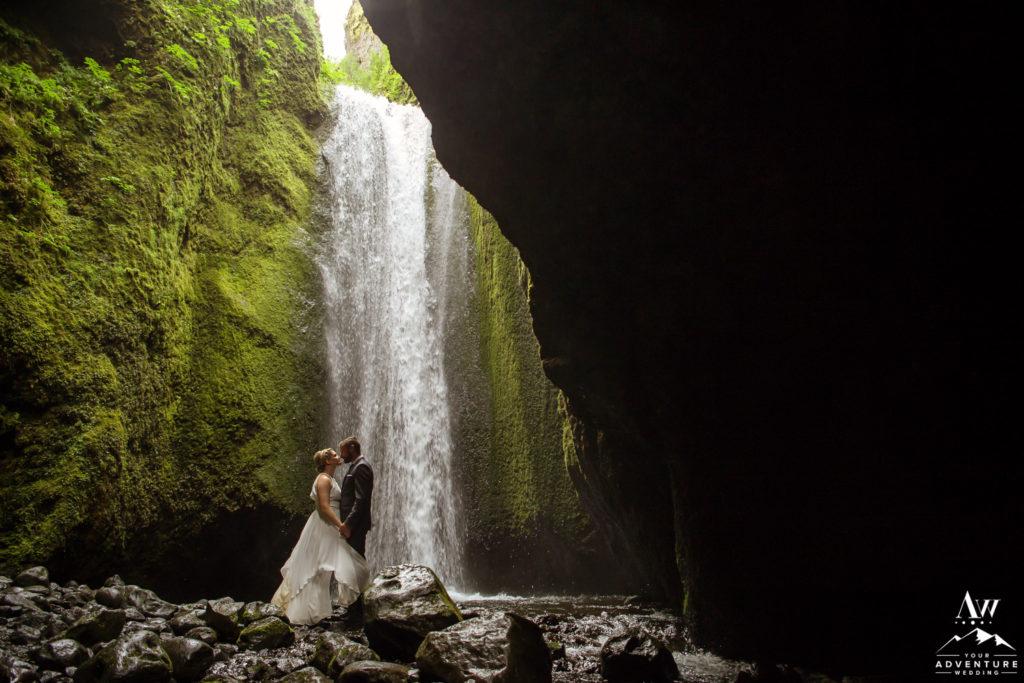 Couple inside of a secret waterfall