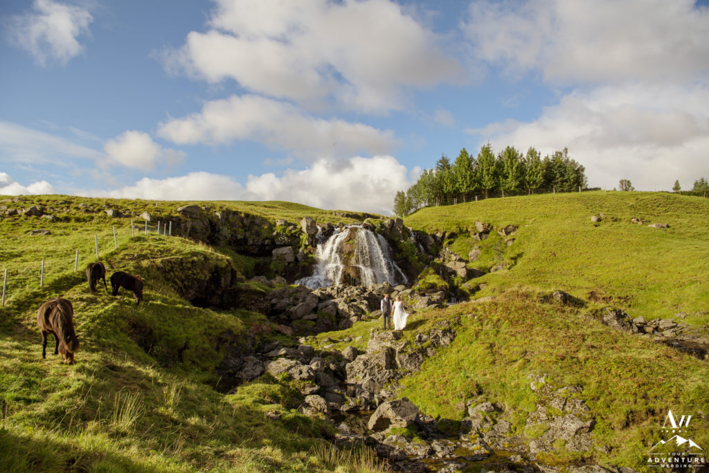 Eloping in Iceland couple exploring a private waterfall