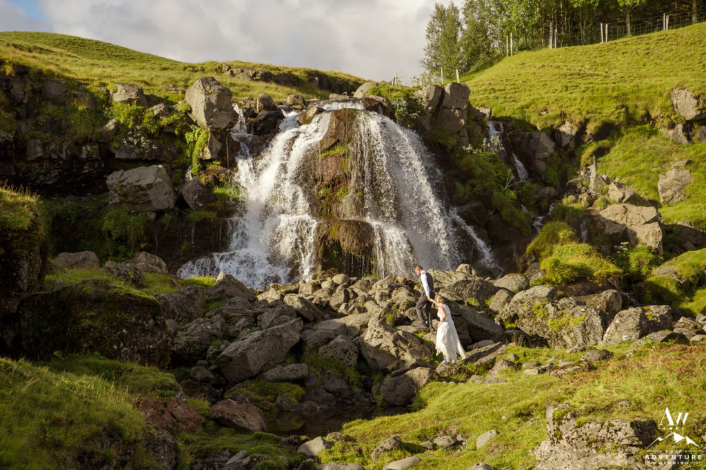 Couple exploring a private waterfall in Iceland