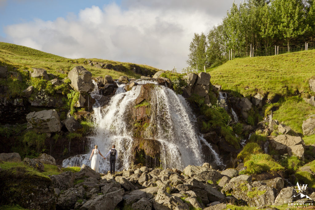 Iceland Elopement couple enjoying a private waterfall
