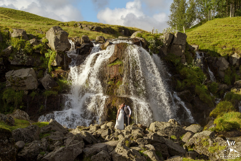 Iceland Wedding Couple kissing in front of a private waterfall