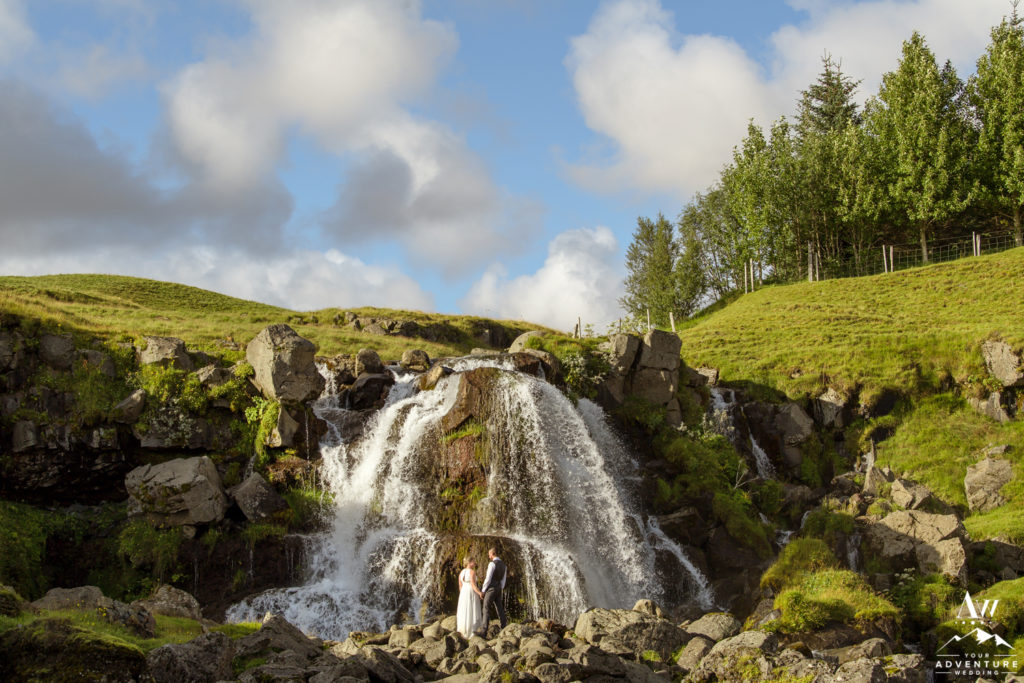 Hiking Elopement couple exploring a private waterfall