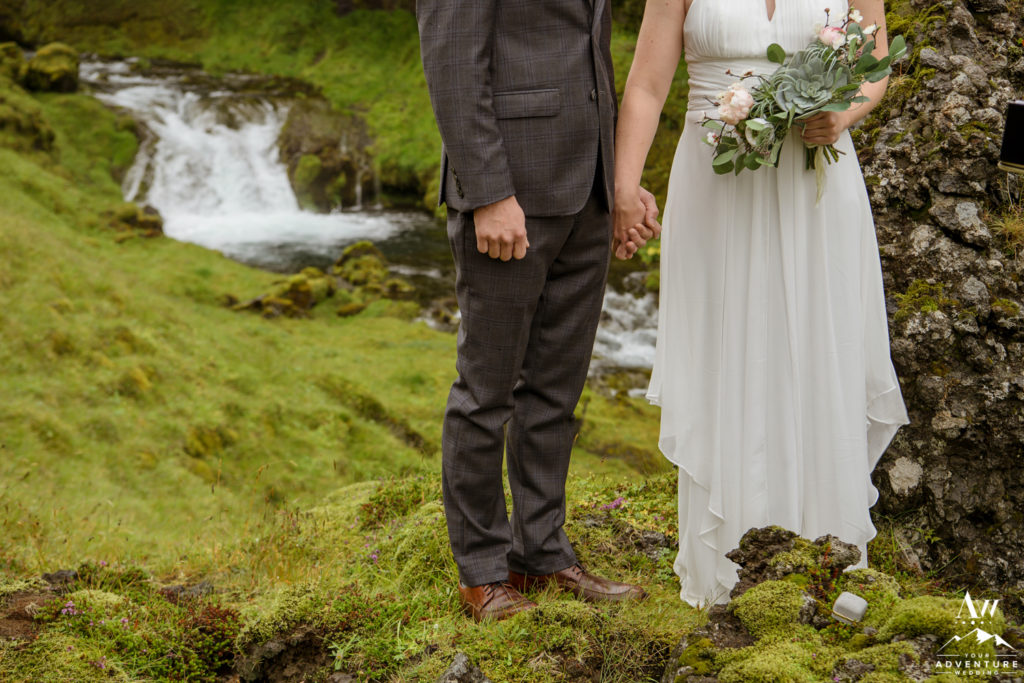 Iceland wedding couple holding hands at their Iceland wedding ceremony