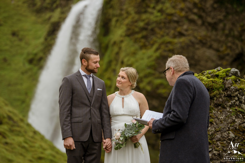 Iceland wedding couple looking at each other during ceremony