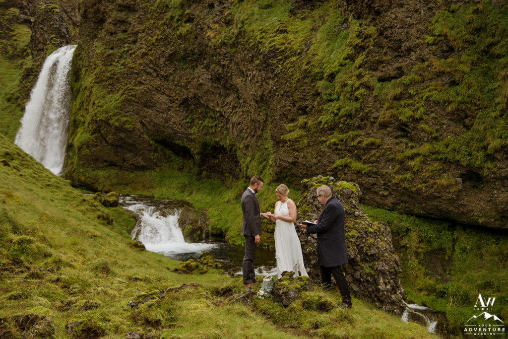 Iceland Wedding Couple exchanging rings during Iceland waterfall ceremony