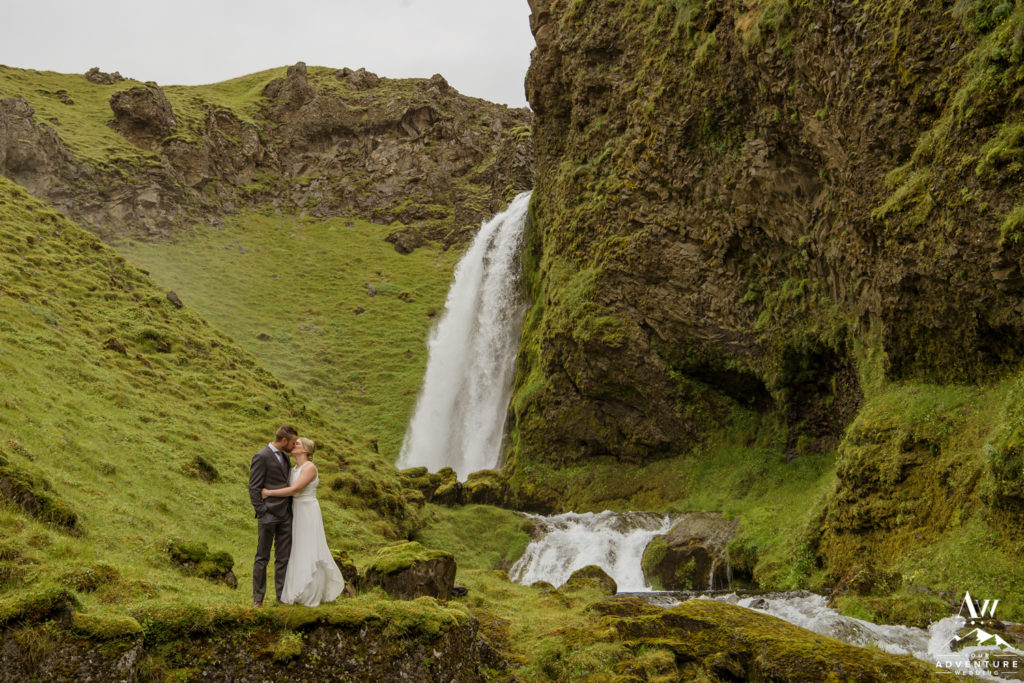 Iceland Elopement Couple kissing at a private waterfall
