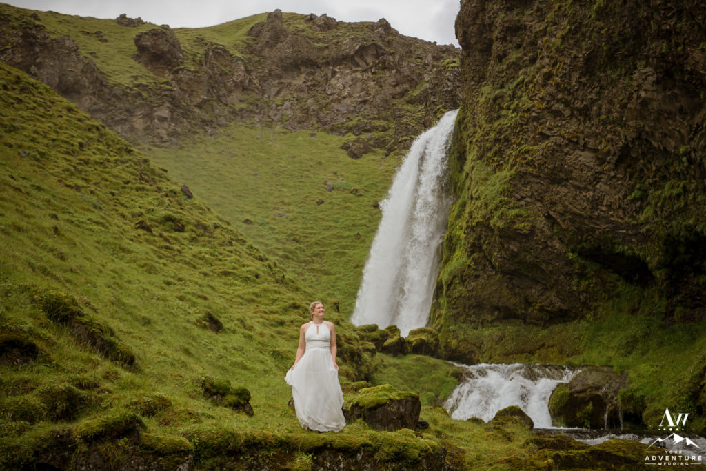 Bride in Iceland in front of a waterfall
