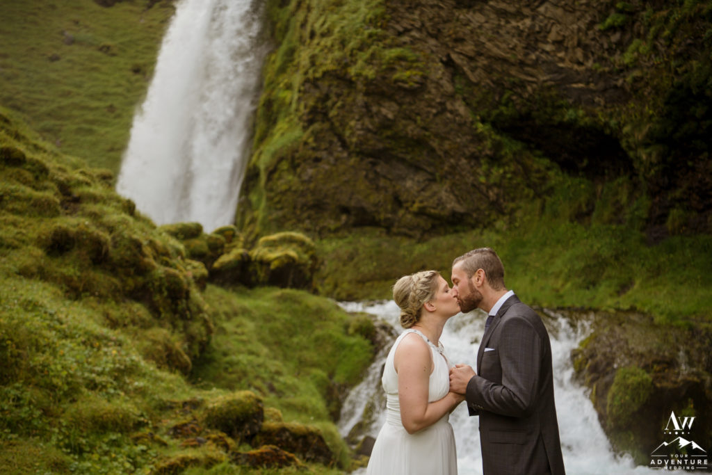 Iceland wedding couple kissing at a waterfall