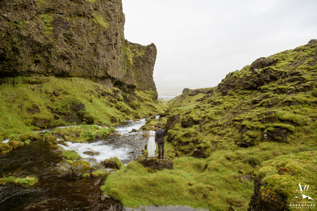Iceland wedding couple standing riverside
