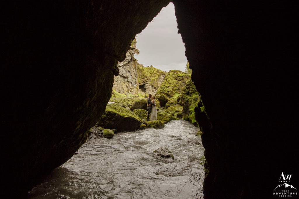 Iceland wedding couple exploring a cave