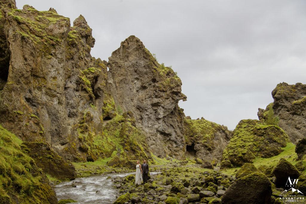 Hiking wedding couple exploring riverside