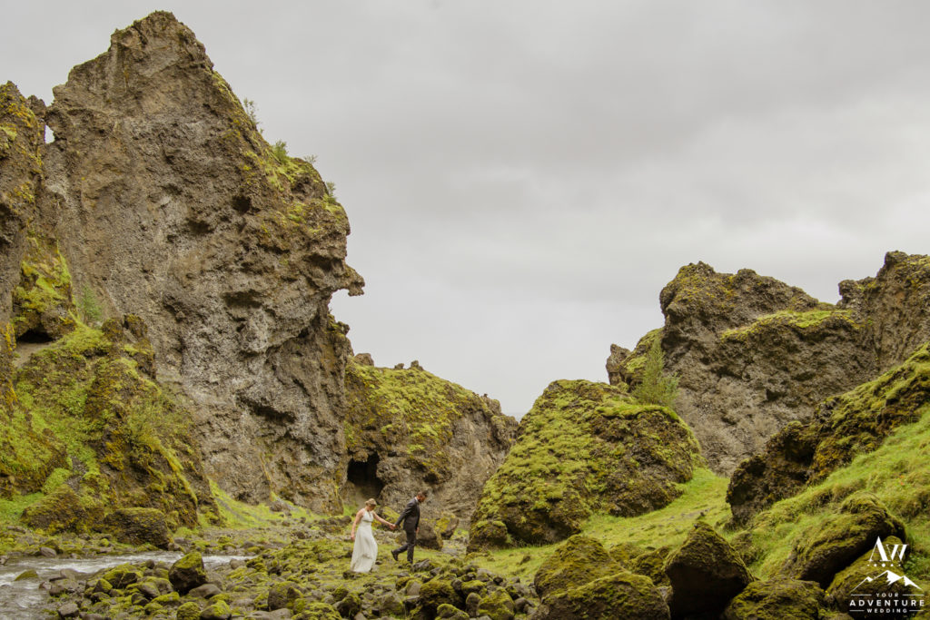 Iceland wedding couple adventuring in a canyon