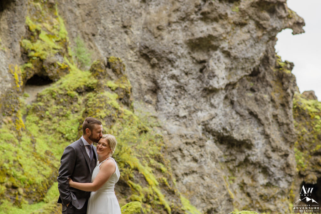 Groom kissing his bride in a canyon in Iceland