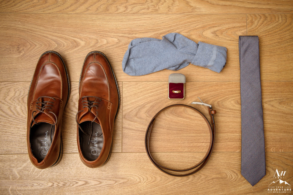 Groom Details for Iceland Wedding on hardwood floor