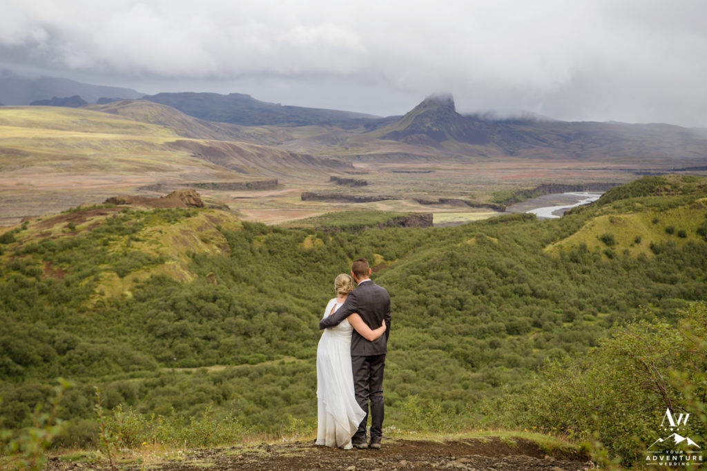 Iceland Wedding Couple hugging looking at mountains