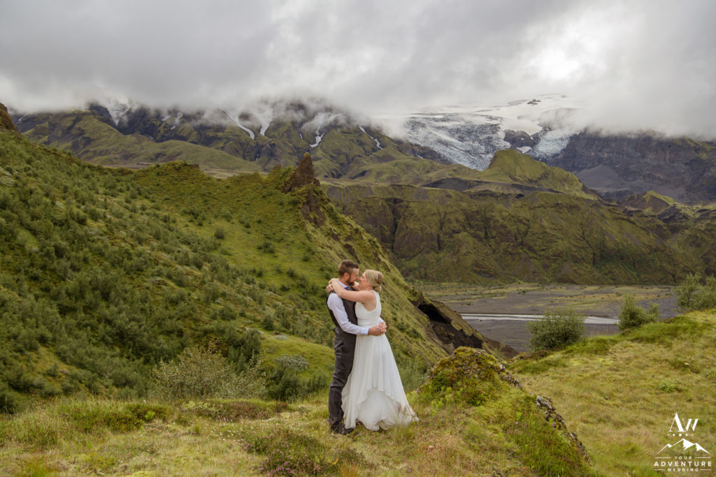 Iceland wedding couple kissing in front of a glacier