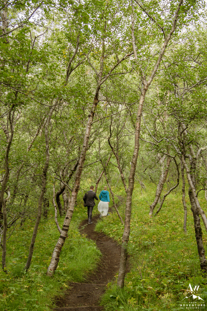 Iceland elopement couple hiking through a forest