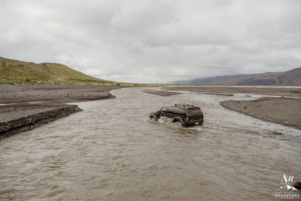 Iceland wedding super jeep crossing a river in Thorsmork