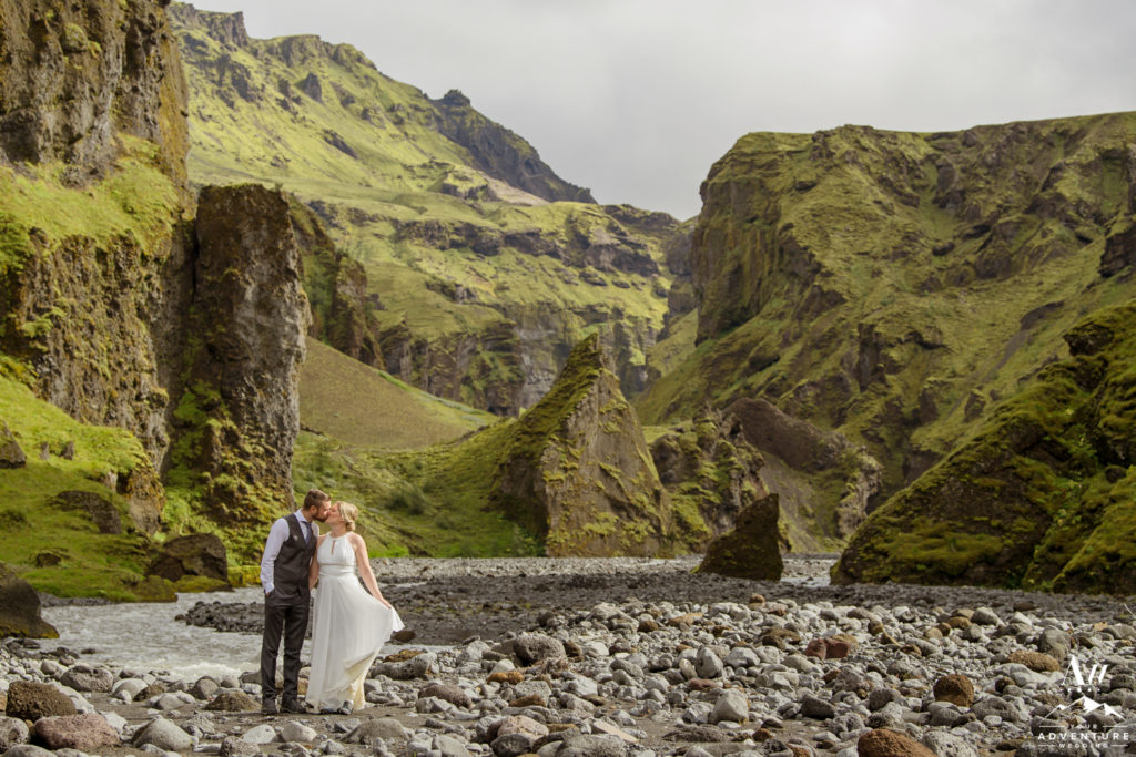 Couple kissing inside of a canyon in Iceland