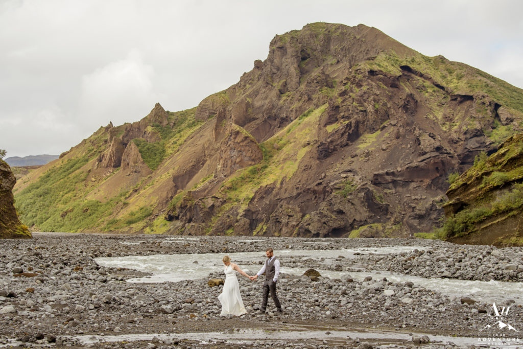 Bride leading her groom in a canyon in Iceland