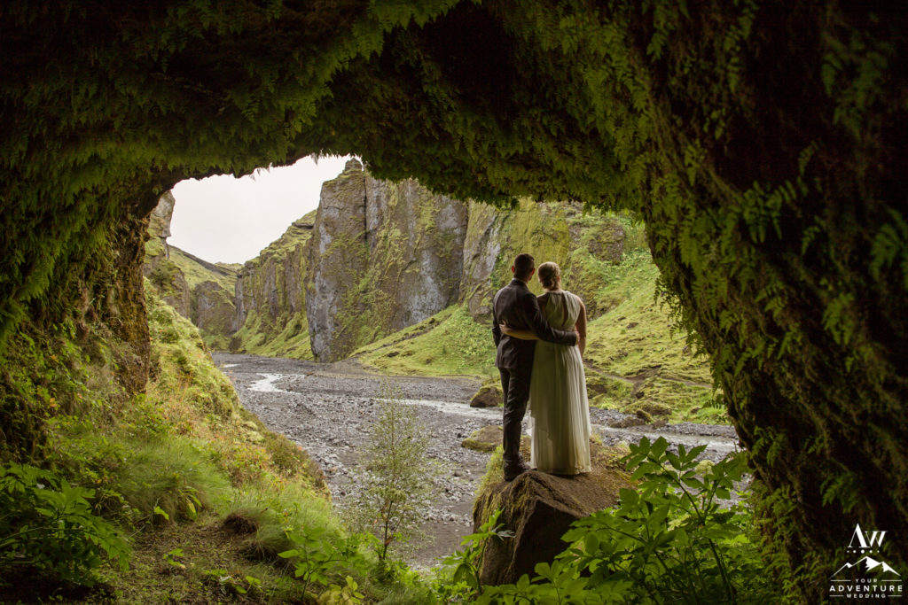 Couple exploring in a cave in Iceland