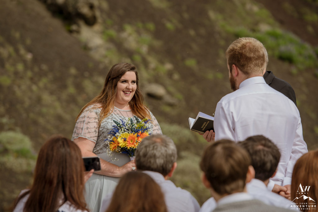 Bride Smiling at her groom at Hjalparfoss Waterfall