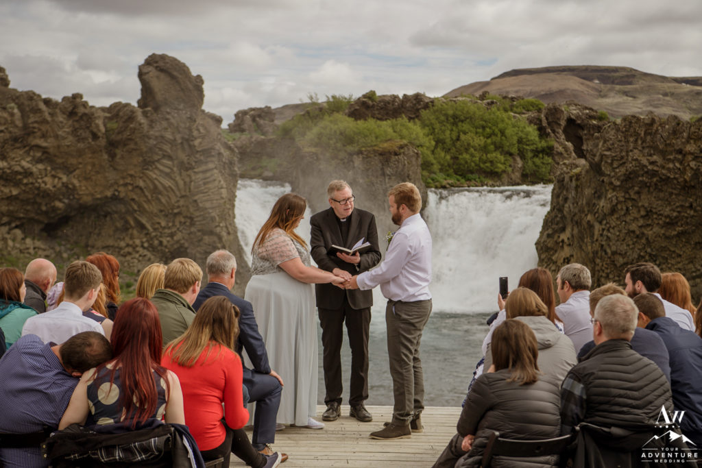 Couple in front of Hjalparfoss Waterfall