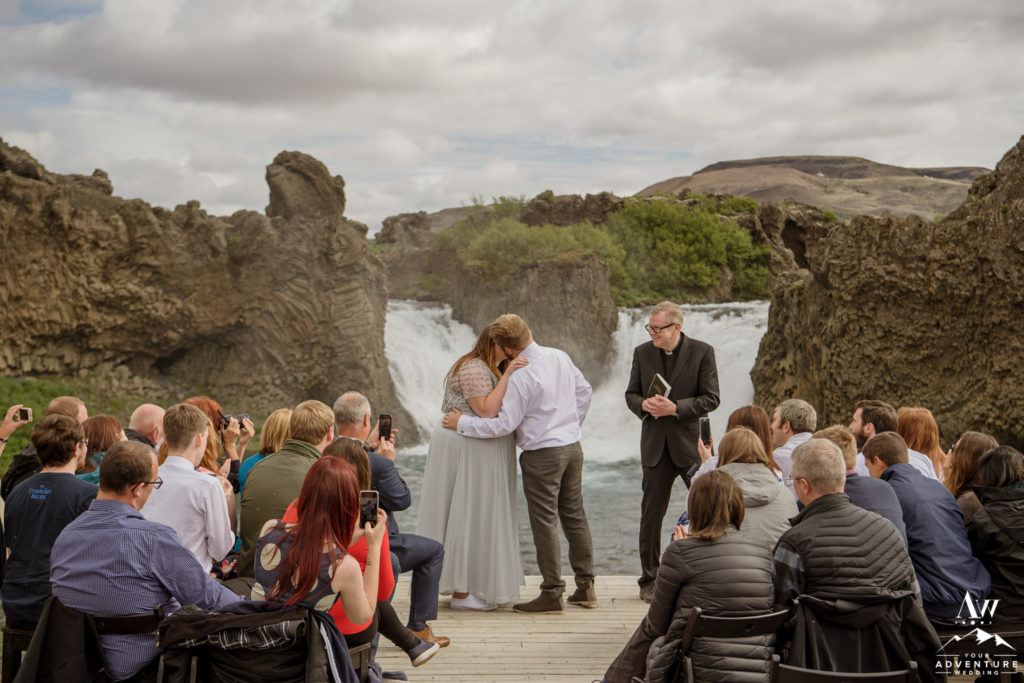 Iceland Wedding Couple Kissing in front of Hjalparfoss Waterfall