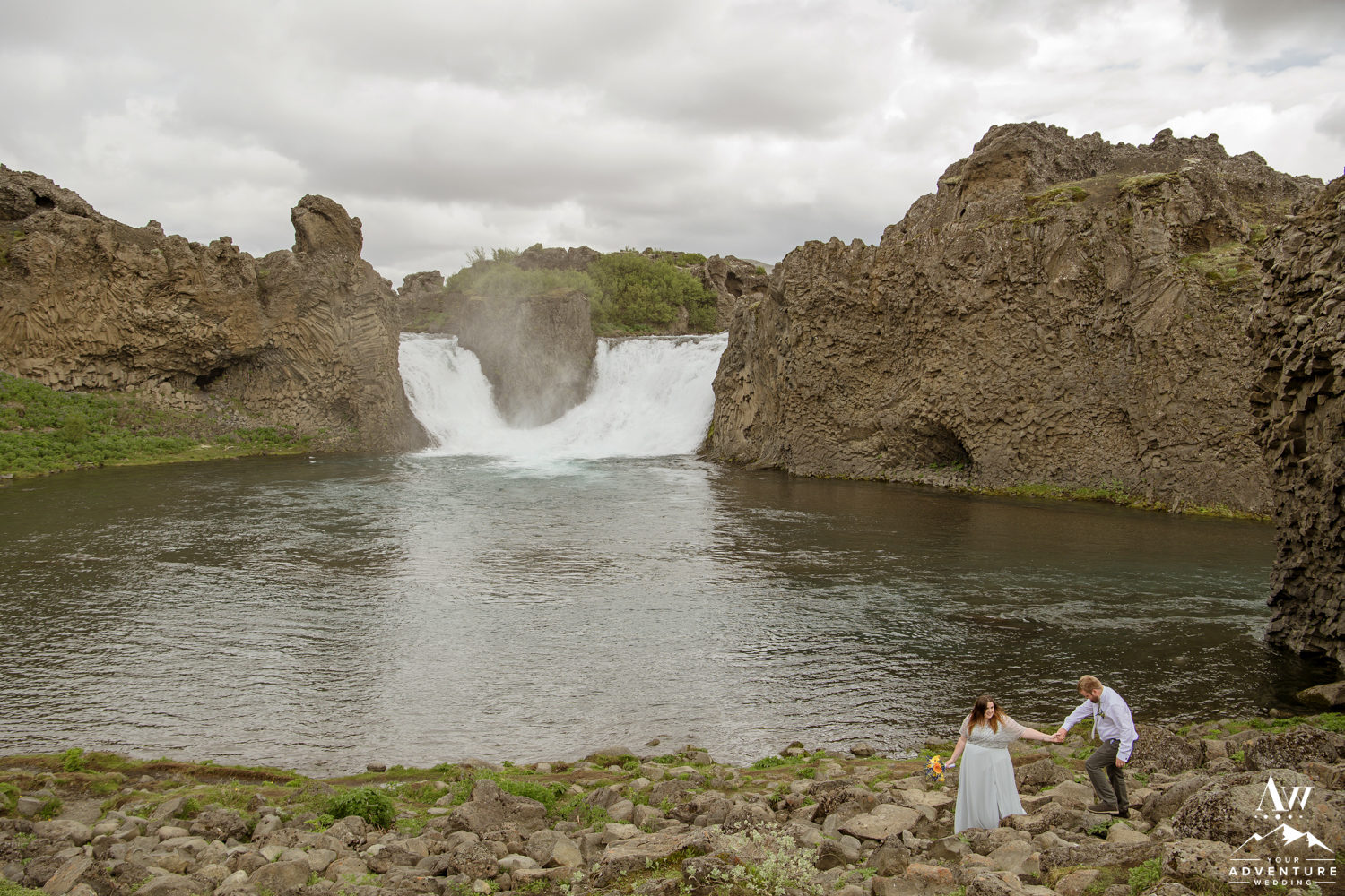 Iceland Wedding Couple Exploring Hjalparfoss Waterfall