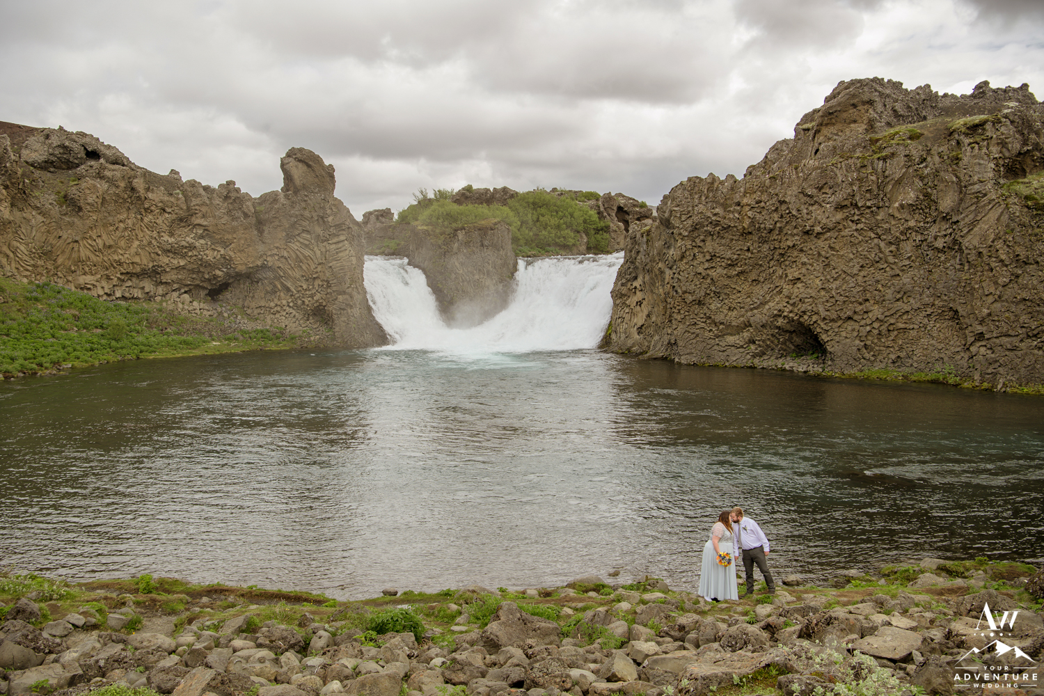 Couple Kissing at Hjalparfoss Waterfall