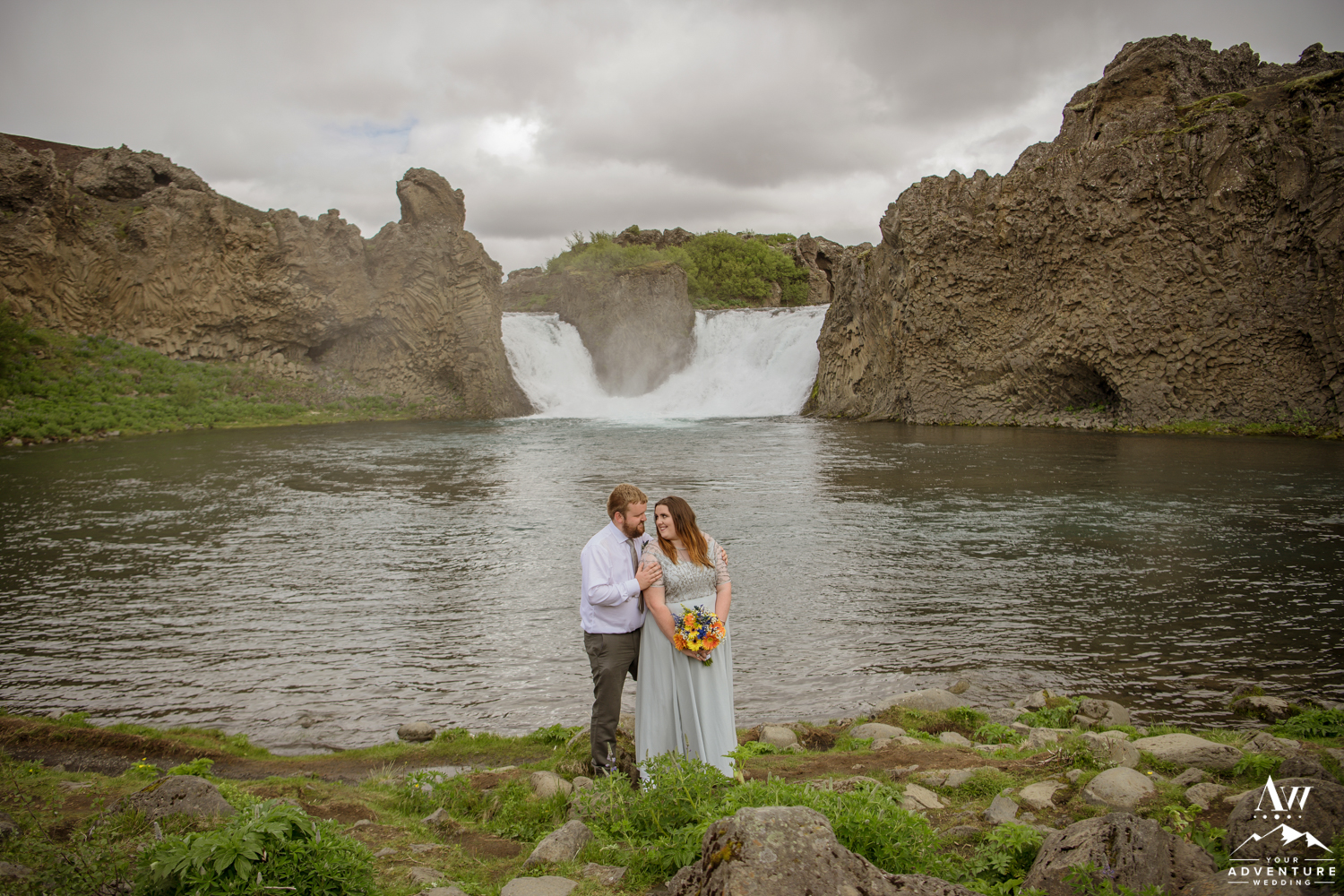 Iceland Wedding Couple in front of Hjalparfoss Waterfall