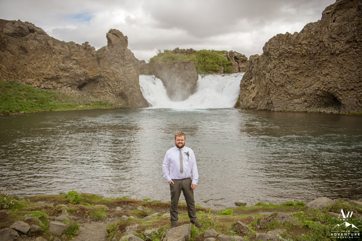 Iceland Wedding Groom in front of Hjalparfoss Waterfall
