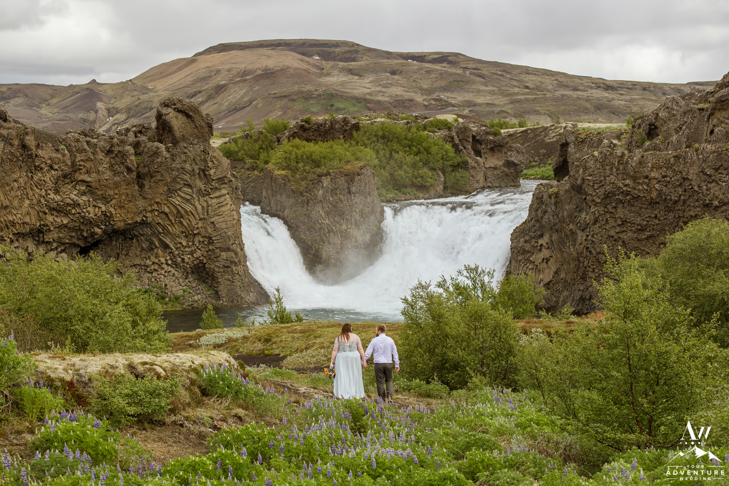 Adventure wedding in Iceland at Hjalparfoss Waterfall