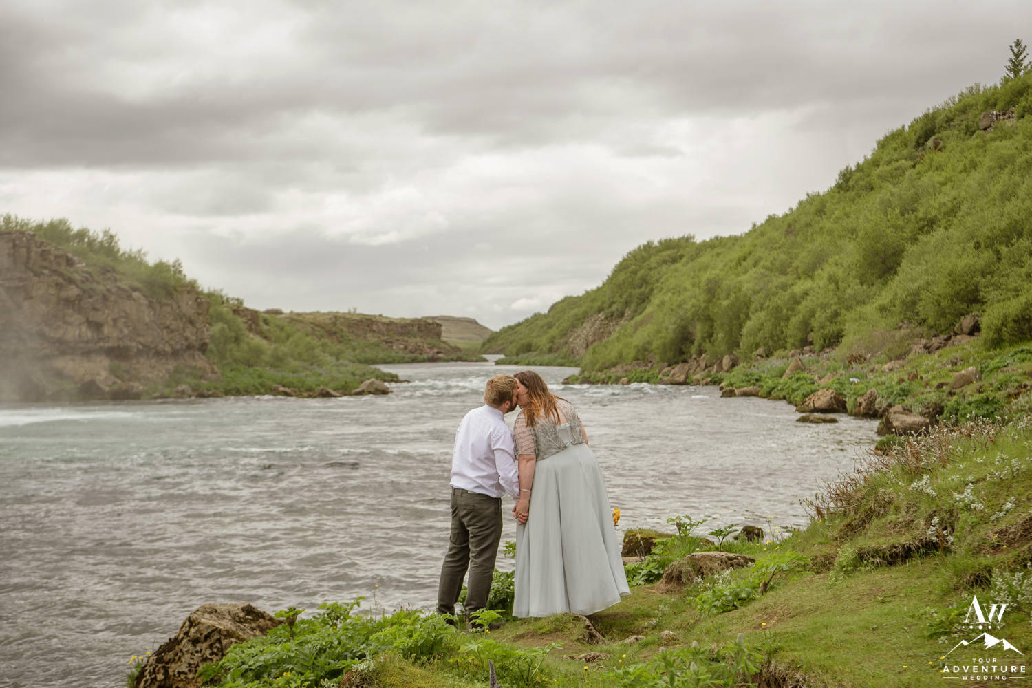 Emily and Danny kissing at Faxafoss Waterfall
