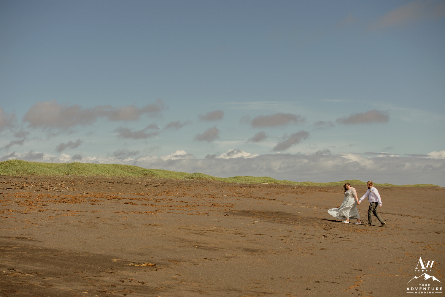Iceland Wedding Couple walking on black sand beach