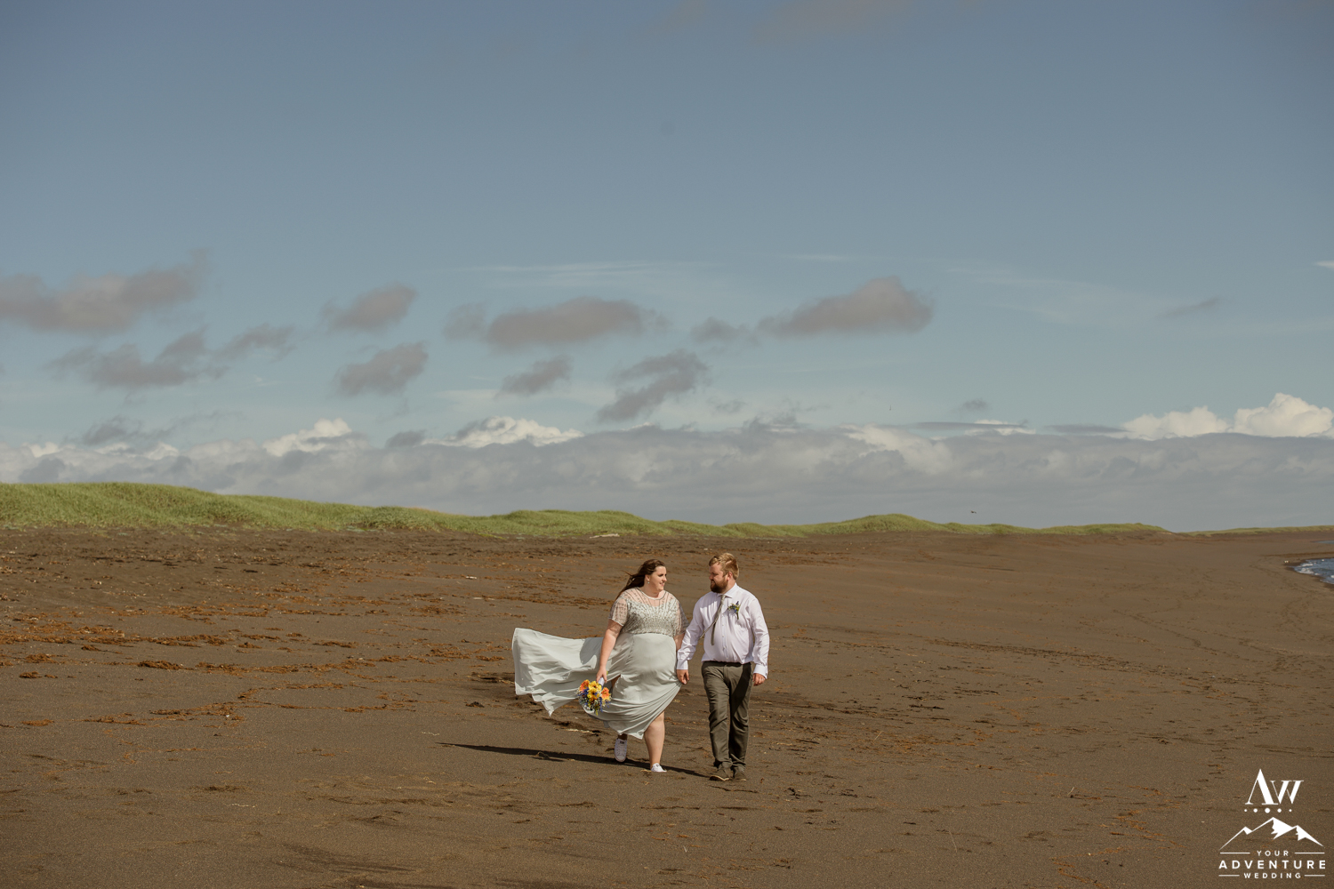 Iceland Wedding Couple exploring black beach