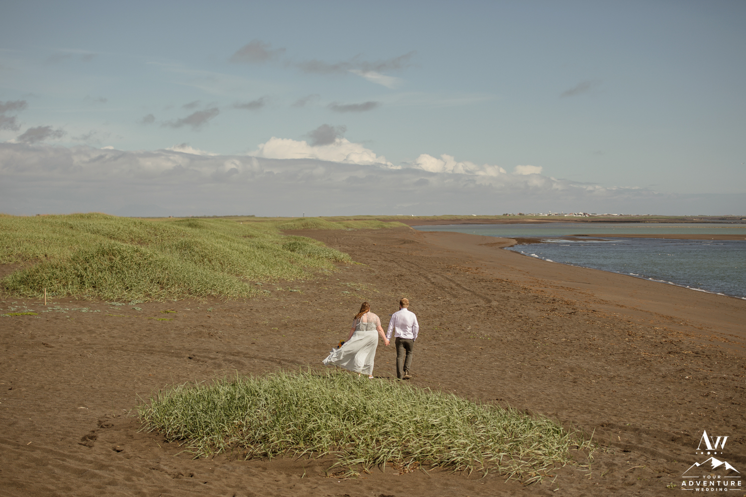 Couple walking exploring during Iceland wedding day