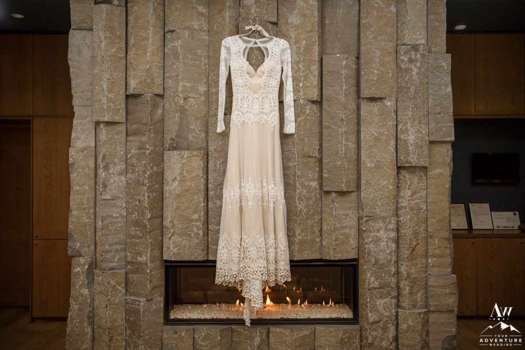 Iceland Wedding Dress hanging above a fireplace