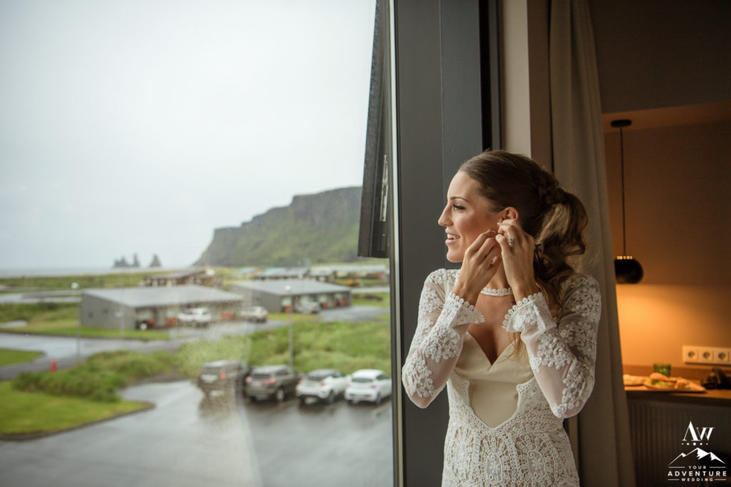 Iceland Elopement Bride putting on her earrings