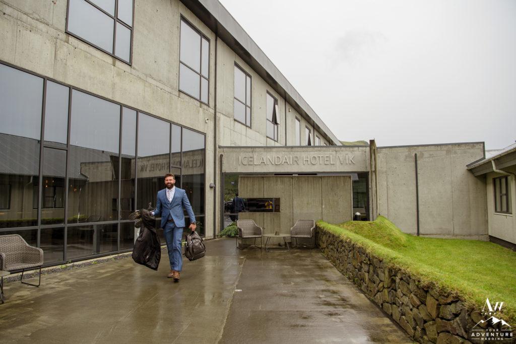 Groom walking outside of Icelandair Vik