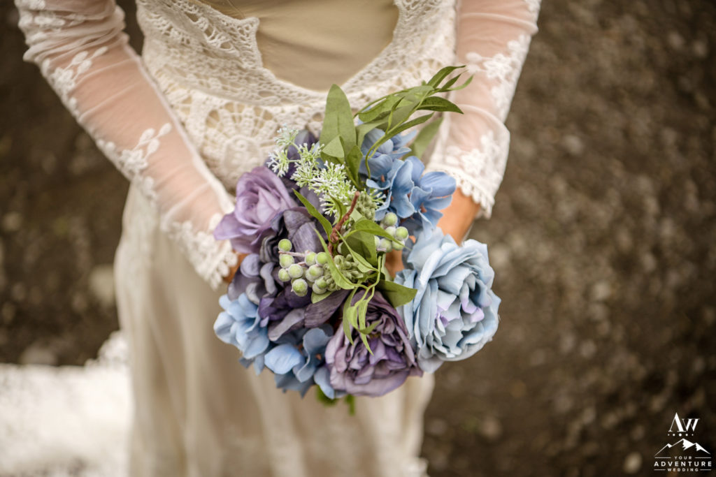 Bride Holding her Blue and Purple Bouquet