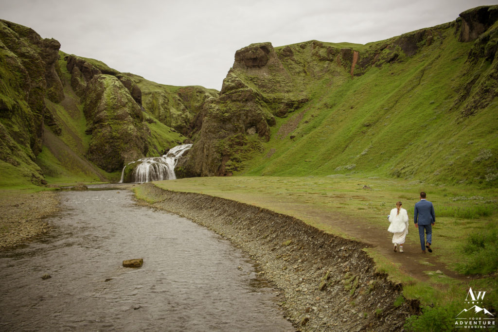 Iceland Wedding Couple Walking to Waterfall Ceremony