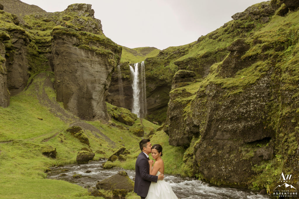 Luxury Wedding Iceland Couple in front of Kvernufoss