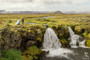 Photo of couple on top of waterfall by Vik Elopement Photographer