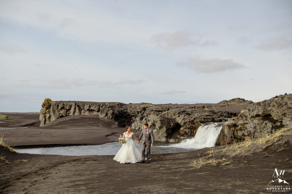 Iceland Wedding Couple on black beach waterfall