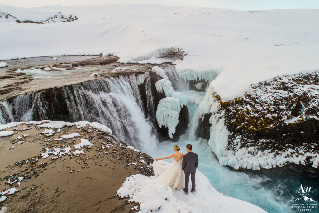 Winter Wonderland Wedding Adventure Couple at a Waterfall